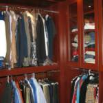 This Cherry custom closet fits wall to wall and floor to ceiling leaving no dead space whatsoever.  It features glass doors, thick closet poles, full extension drawers, along with cherry shelves.